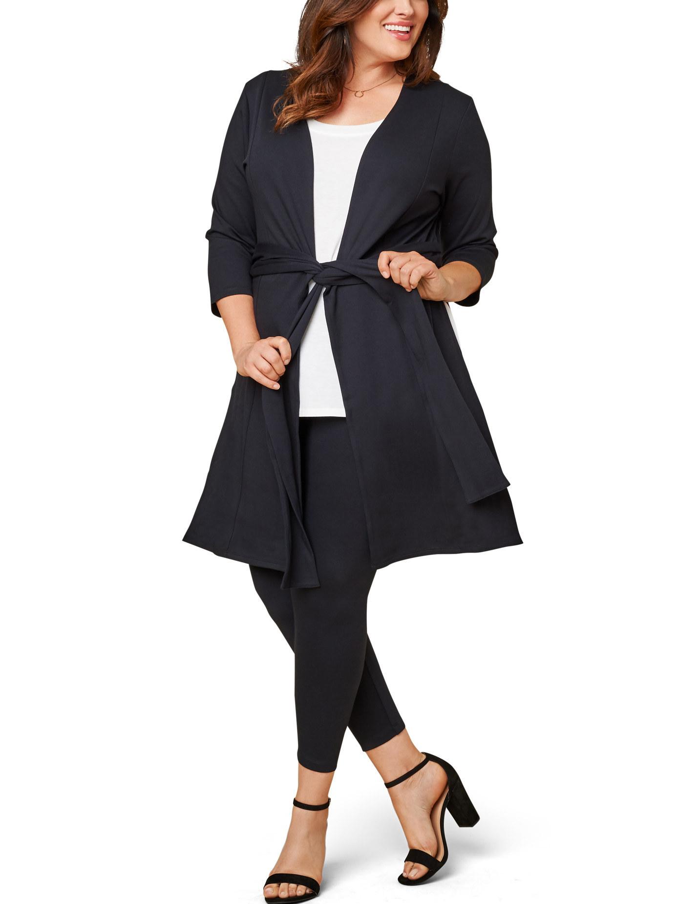 Model wears open front cardigan in brilliant black
