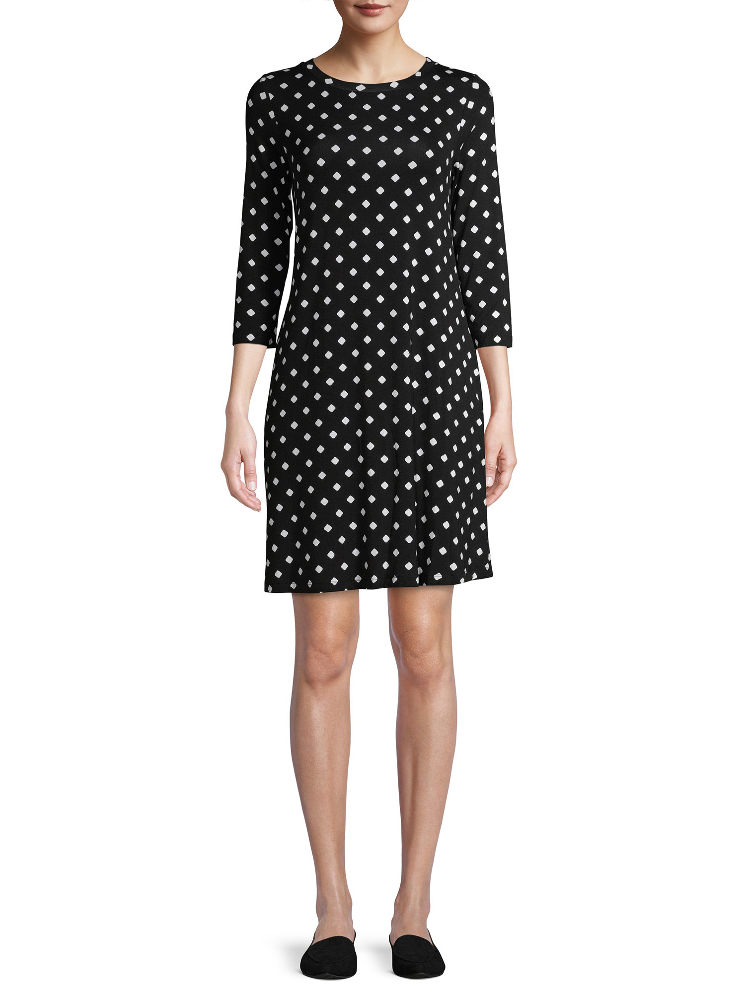 Model wearing black dress with white dots