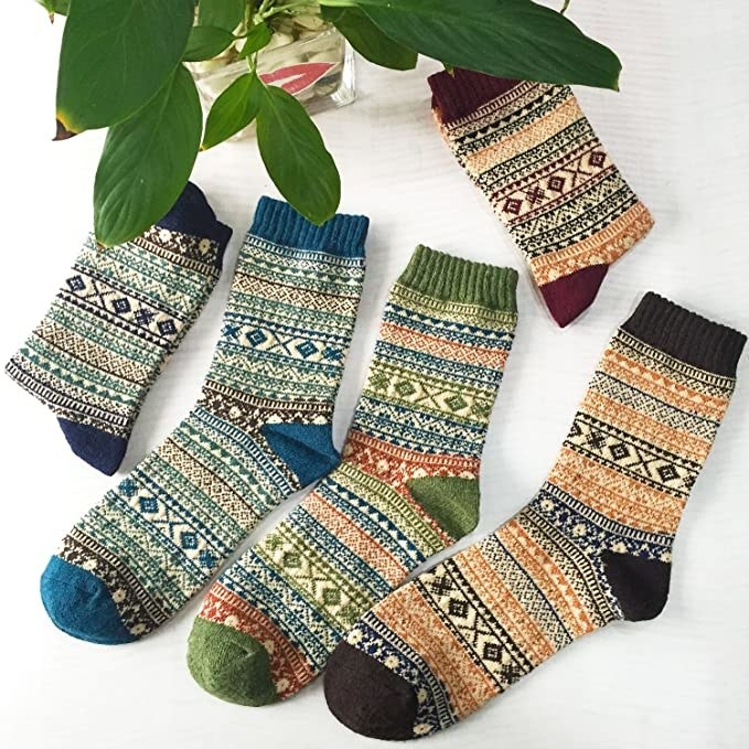 Five pairs of socks in a vintage pattern and different earth tone patterns