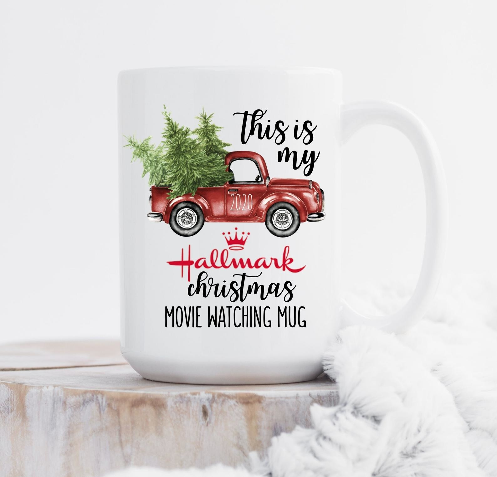 "Holiday themed mug with an old red truck and trees in the bed, with text that says, ""This is my Hallmark Christmas Movie Watching Mug"""