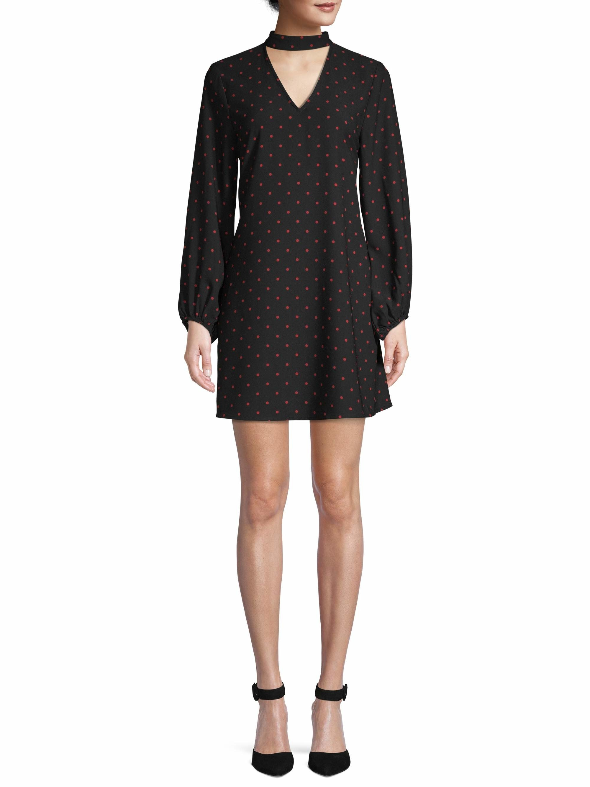 Model wearing black mini dress with red dots and keyhole neckline