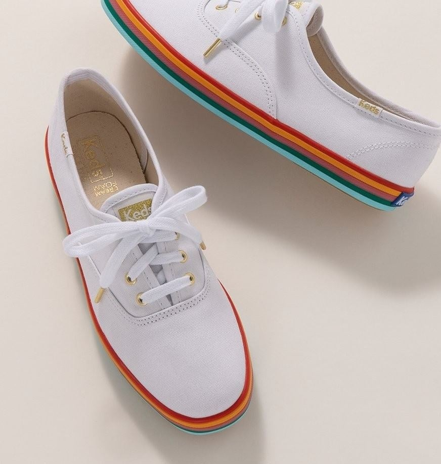 A pair of rainbow-soled Keds