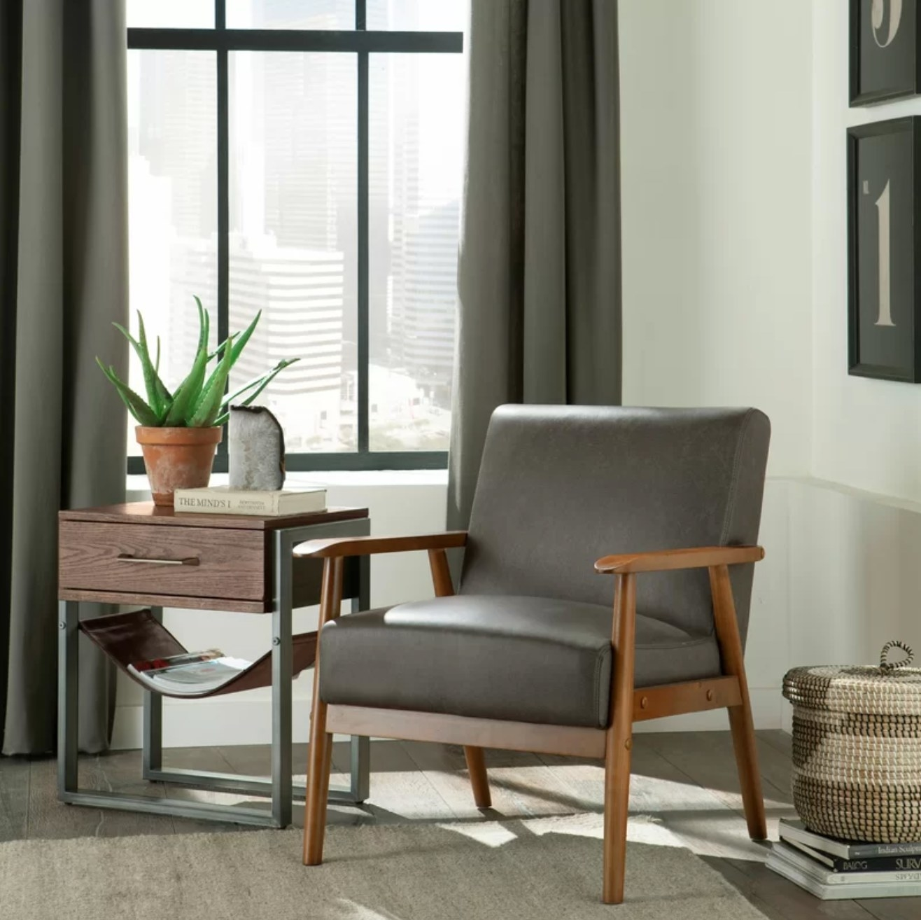 The arm chair in the steel polyester blend next to a side table with a plant and geode