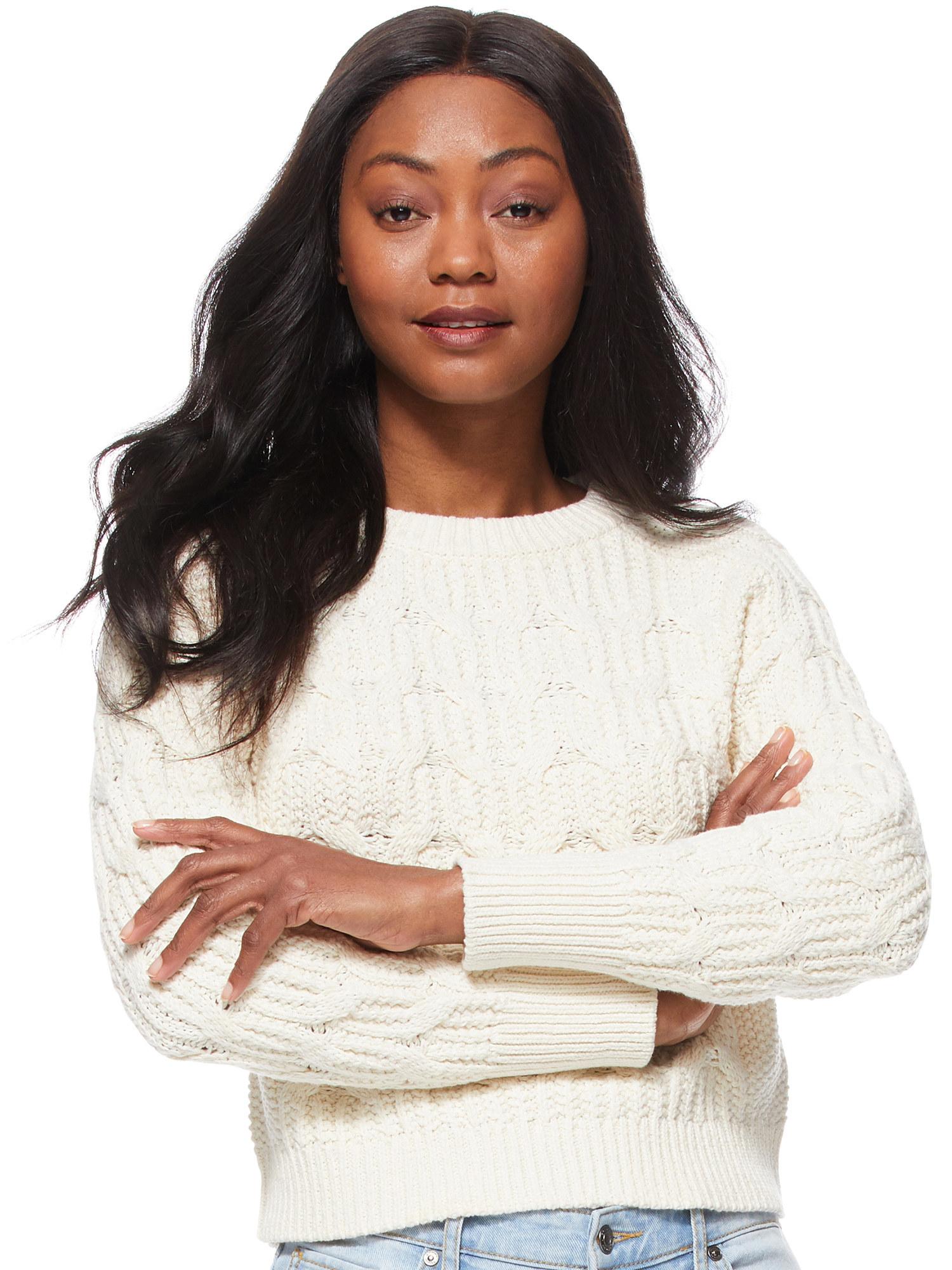 Model wears sweater in ivory