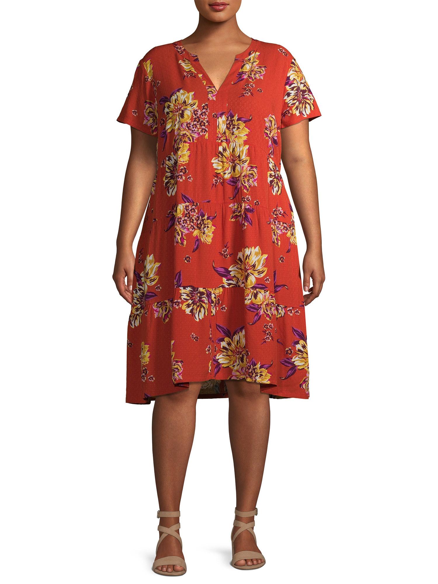 Model wears dress in orange harvest