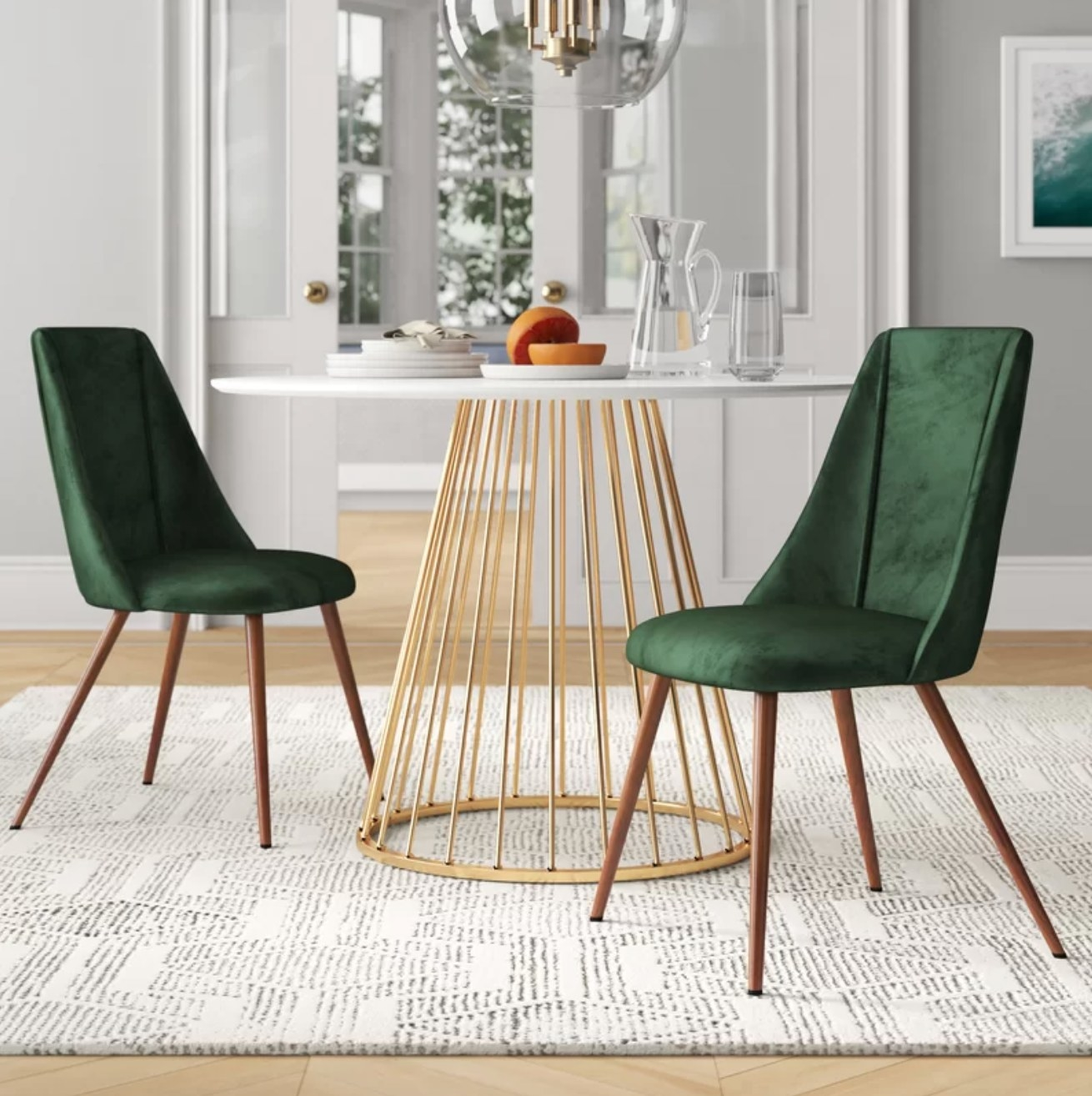 The chairs in green by a dining table holding a halved grapefruit on a plate
