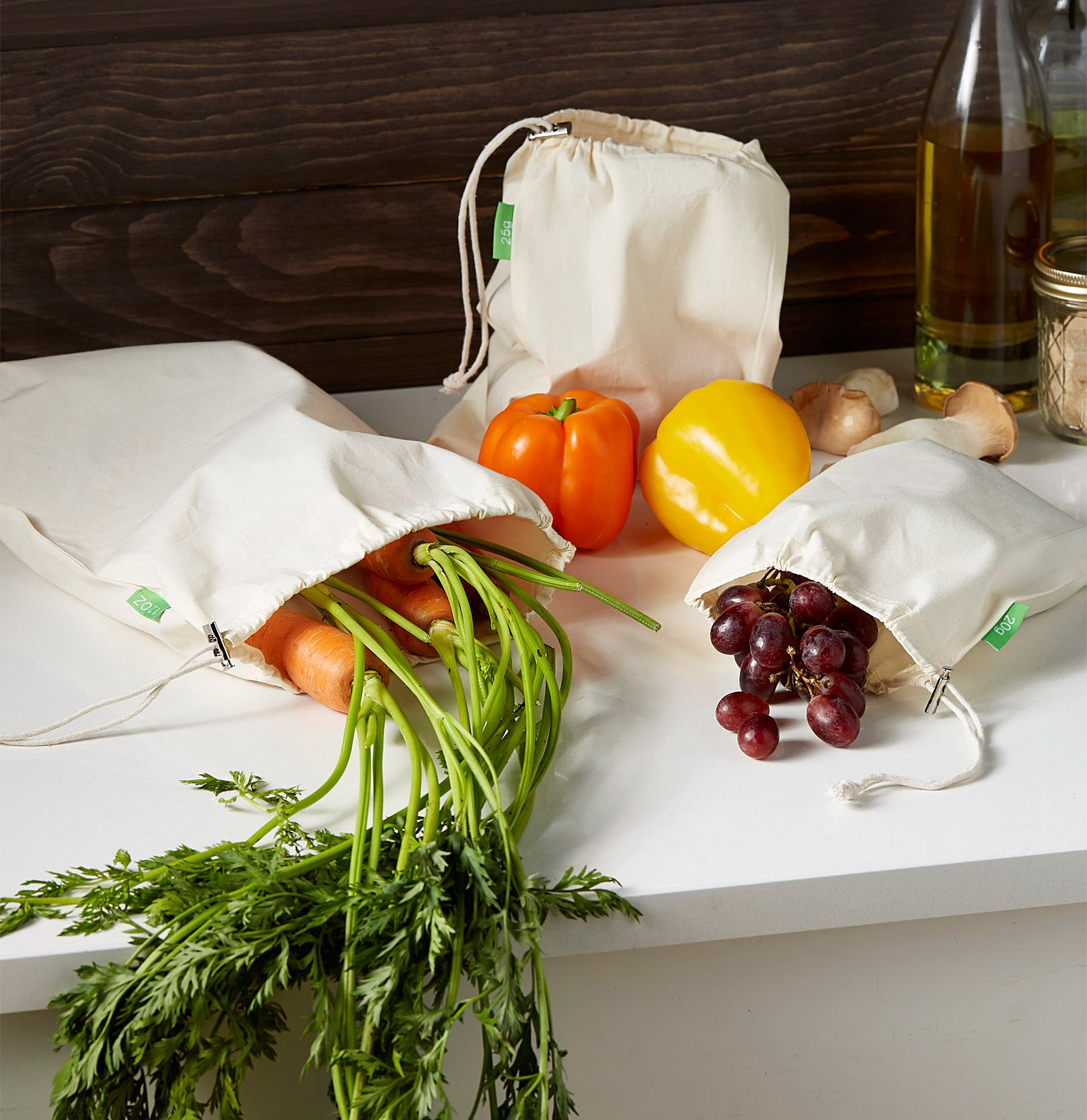 The three produce bags filled with fruits and vegetables
