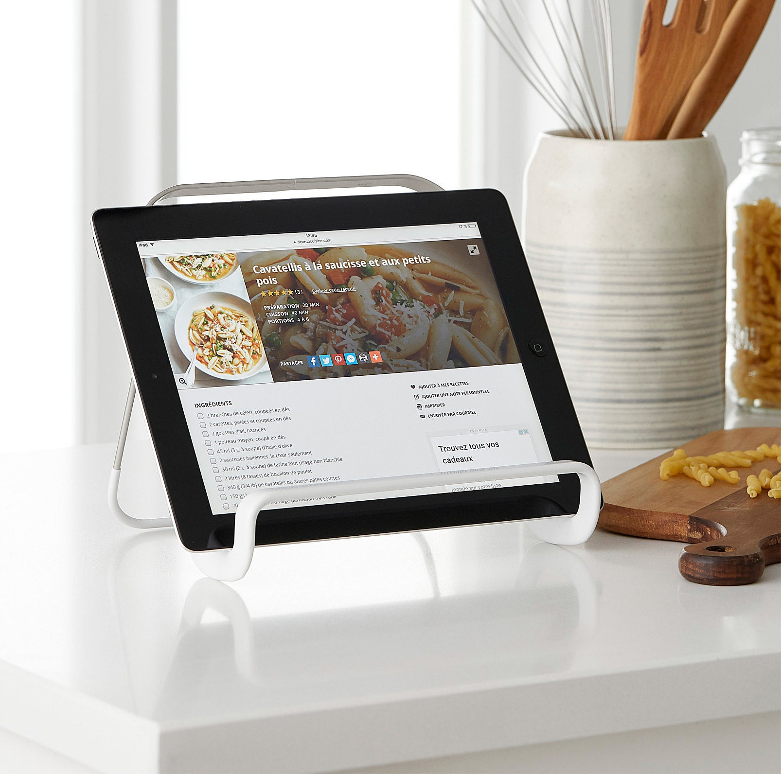 A tablet propped up on a small metal stand