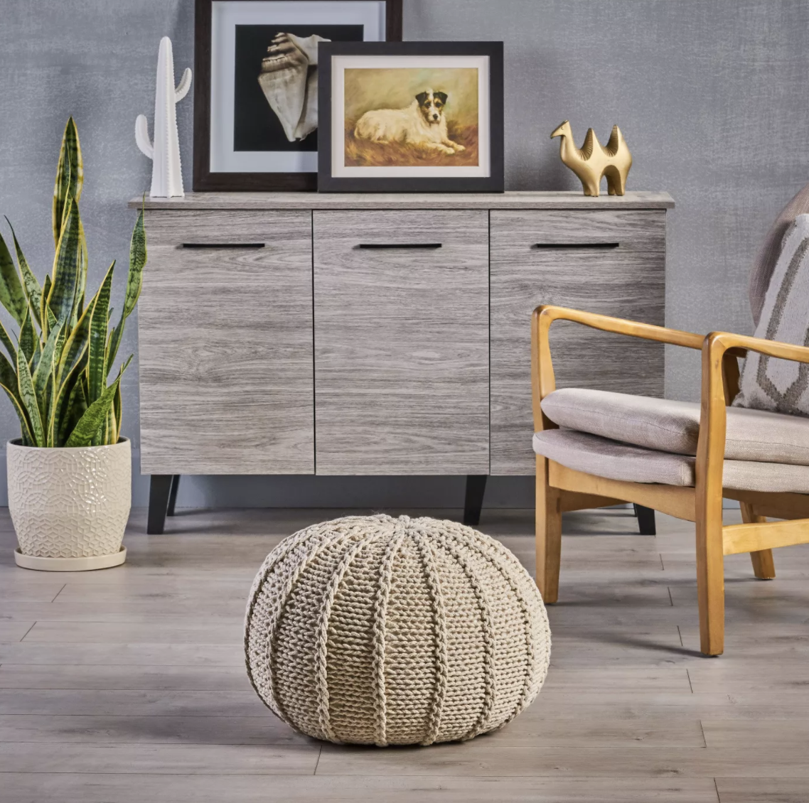 a tan knit pouf in a living room
