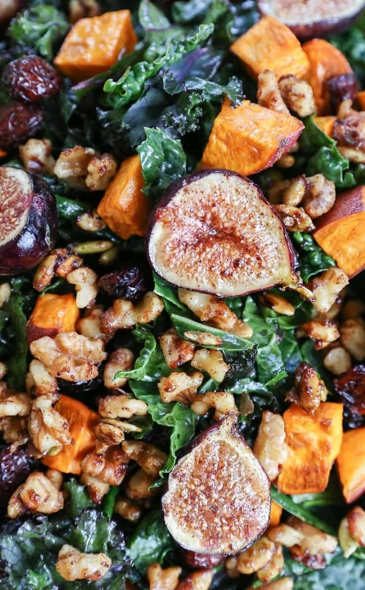A kale salad with walnuts, figs, and sweet potato.