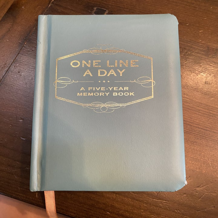 The cover of the small pale blue notebook