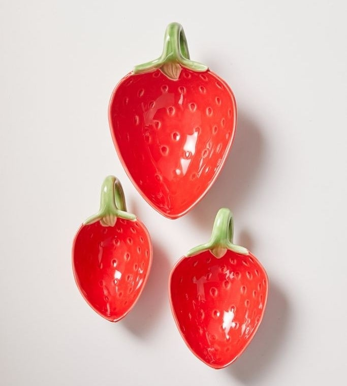 Three strawberry-shaped bowls with a stem that functions as a holder