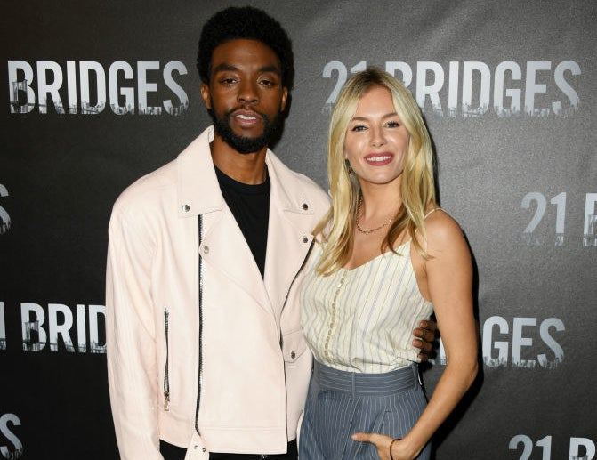 "Chadwick Boseman and Sienna Miller attend the photo call for ""21 Bridges"""