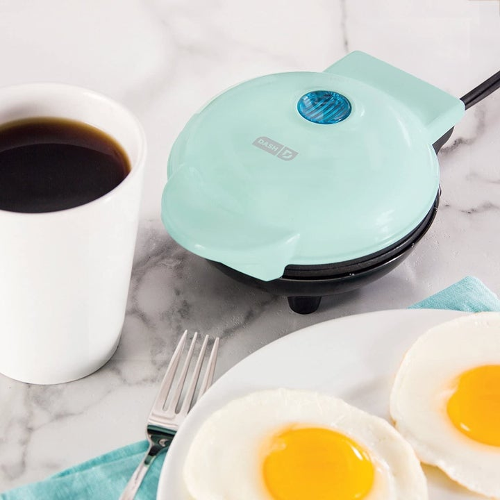 The light blue griddle next to a coffee mug, which it's not much larger in diameter than