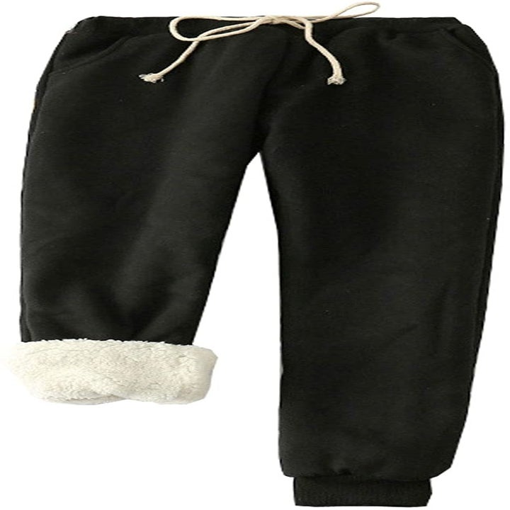 the black sweats with white drawstring and white sherpa lining