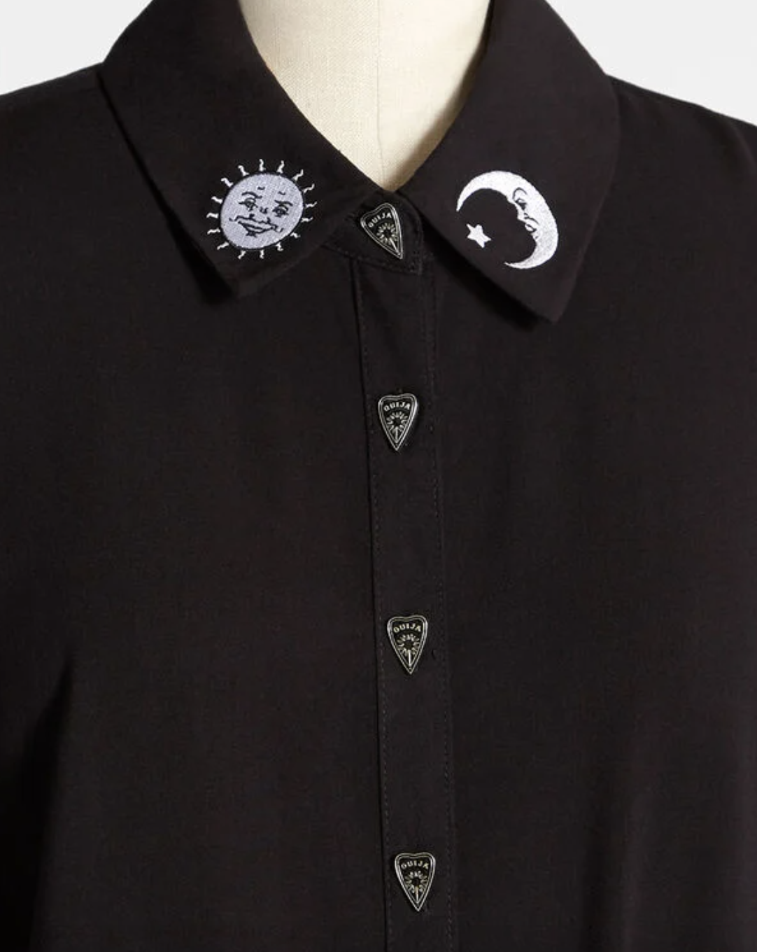 the black button-up with silver ouija buttons and white sun and moon motif on collar