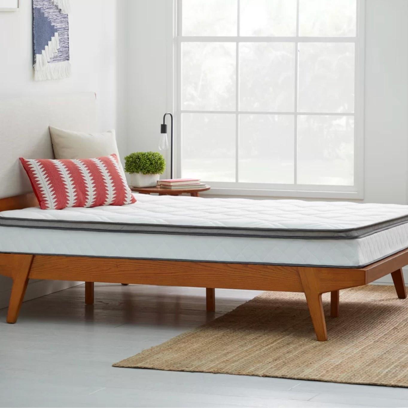 The medium mattress on a wood platform bed frame