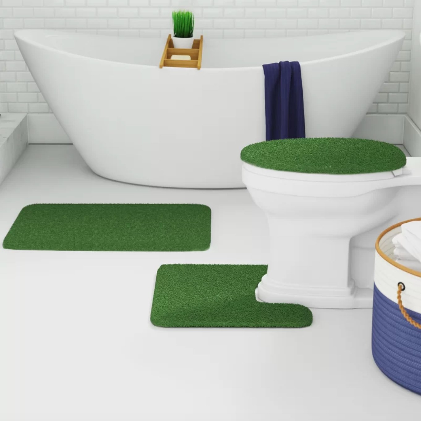 The bath rug set in sage green being used in an all white bathroom