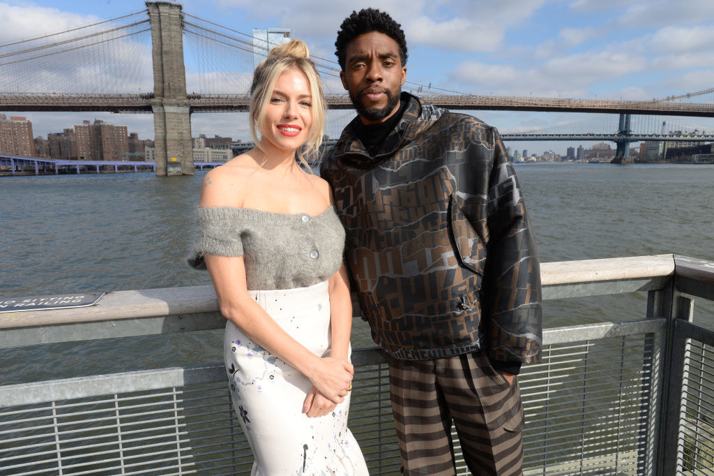 "Sienna Miller and Chadwick Boseman pose during a photo call for ""21 Bridges"""