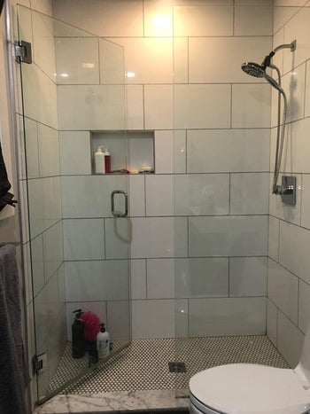 A reviewer's sparkling clean shower with glass doors