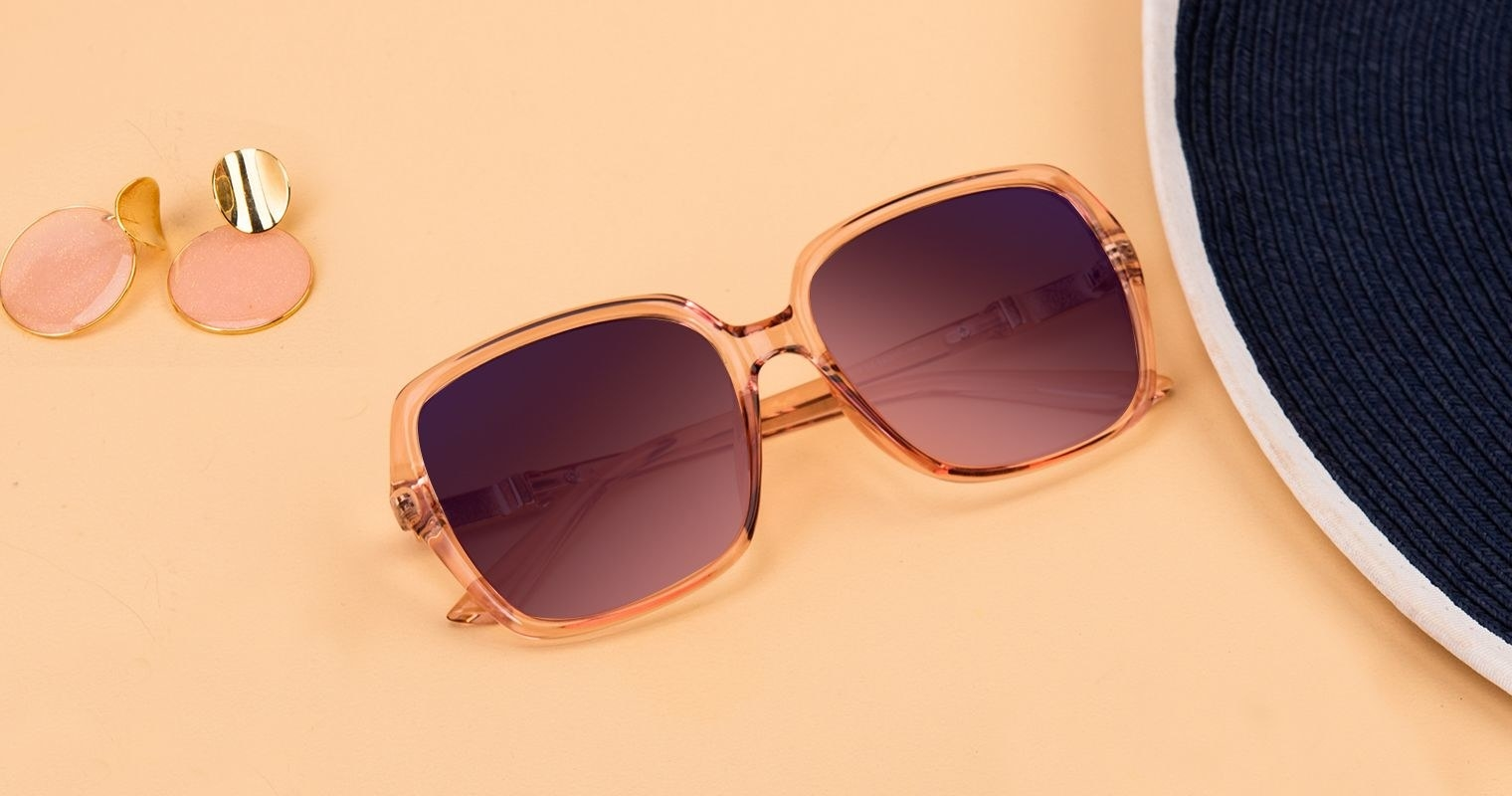 the sunglasses with large lenses and a peach-colored frame