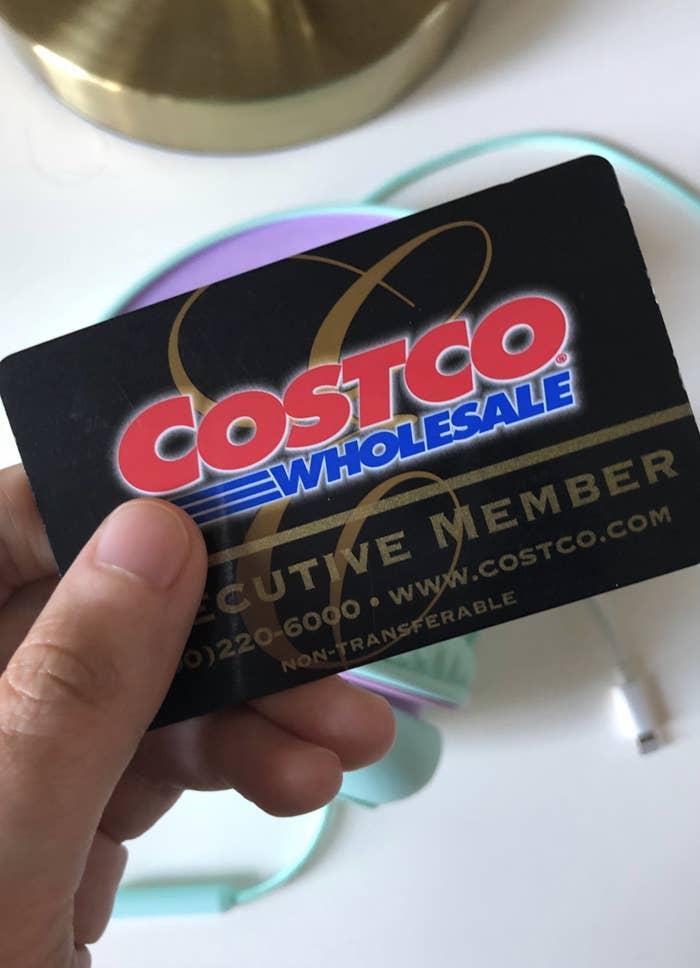 Someone displaying their Costco membership card.