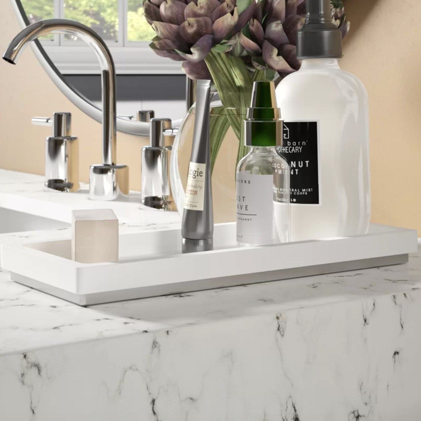 The bathroom accessories tray holding different bath and hygiene products