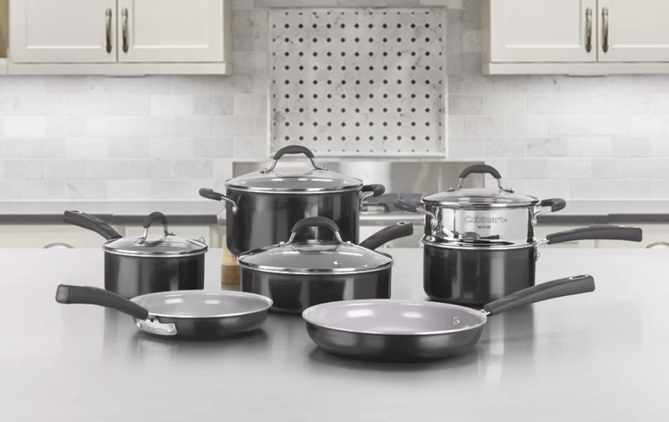The complete cookware set on a kitchen island