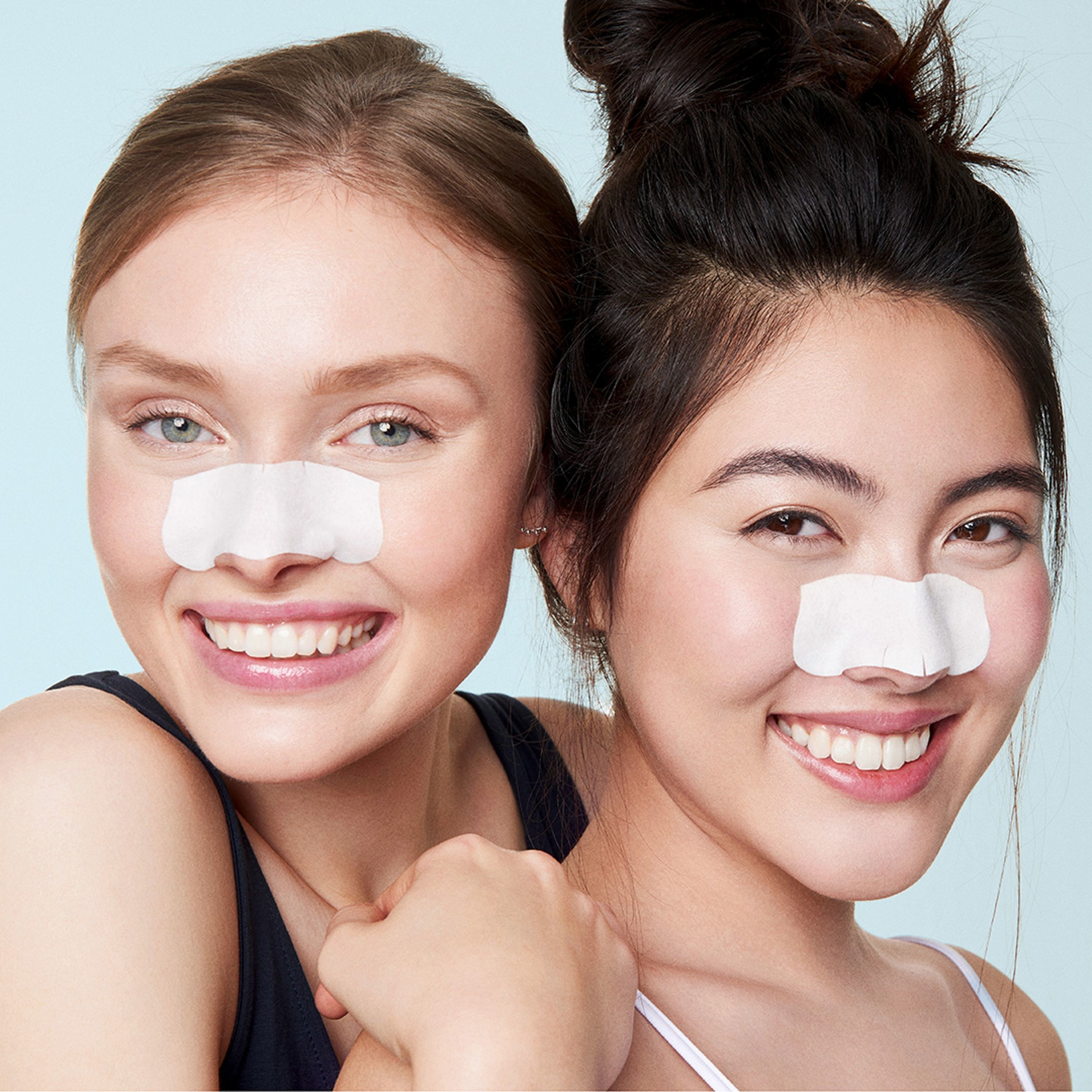 Models wearing Biore strips on their noses