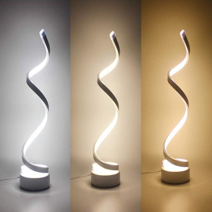 The LENIVER LED Modern Minimalist Spiral Desk Lamp in three different light settings