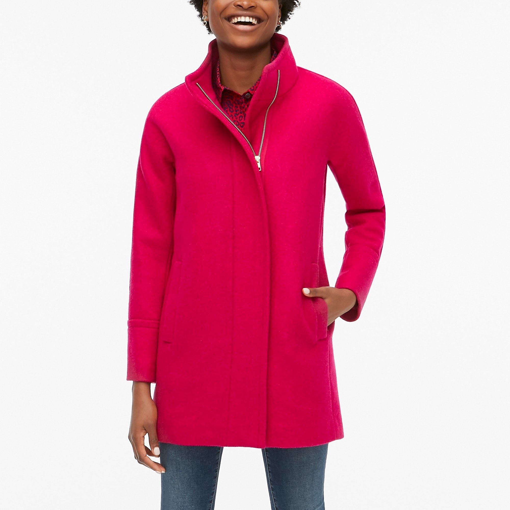 a model wearing the city coat in bright pink