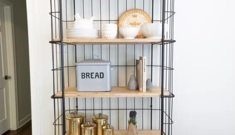 The bread box on display on a wood shelf