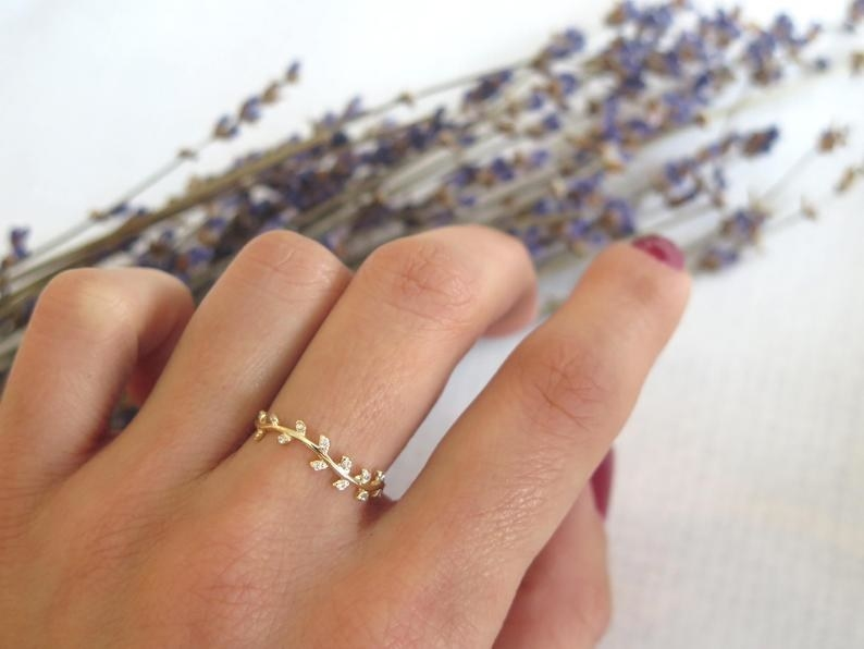 The ring in gold shown on a hand