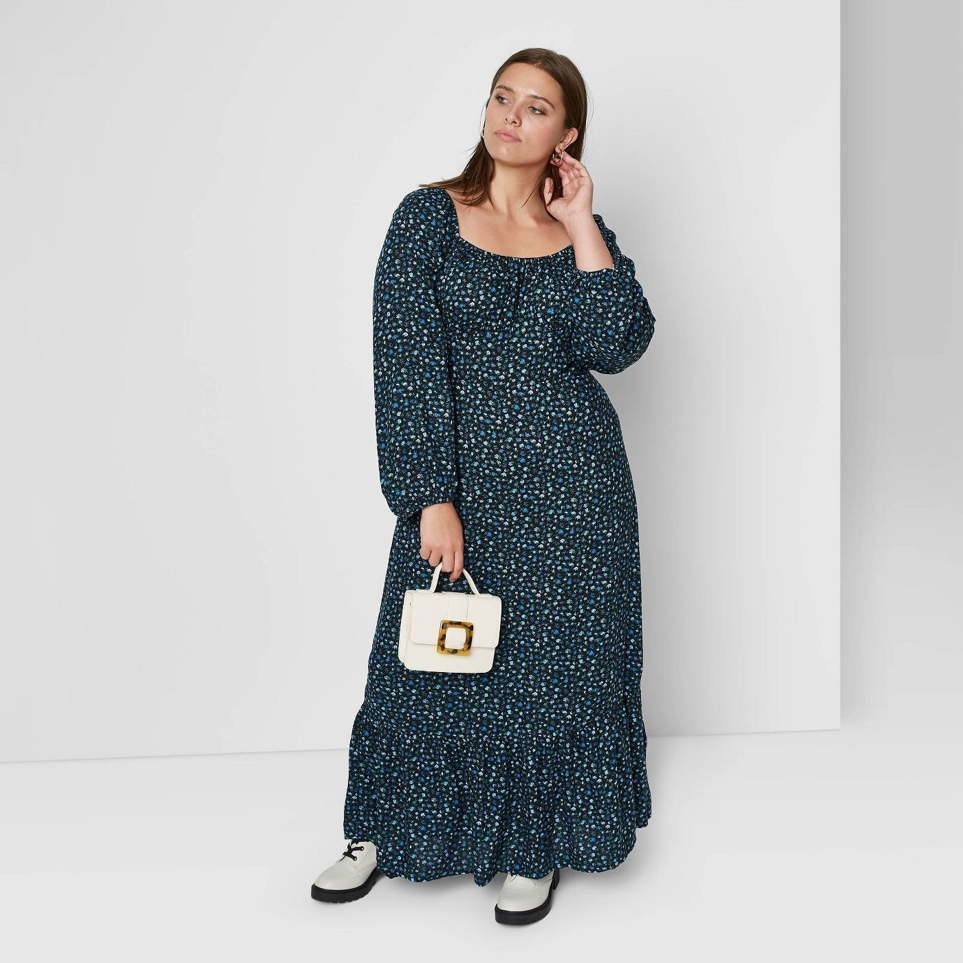 Model wearing the scoop elastic neck ankle-length dress with puff sleeves and a ruffle at the bottom
