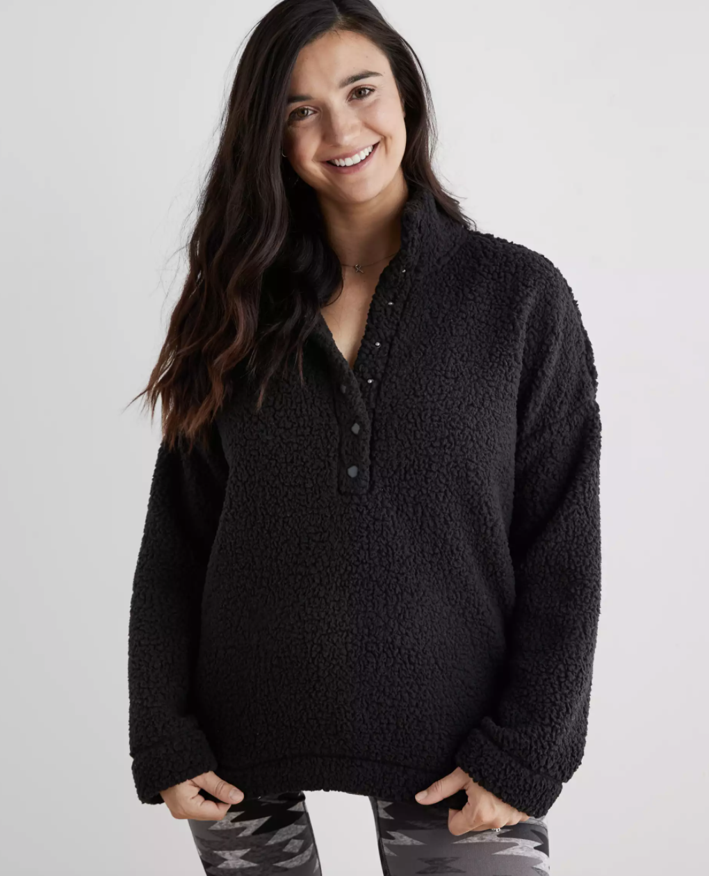 a model in the fuzzy black pullover