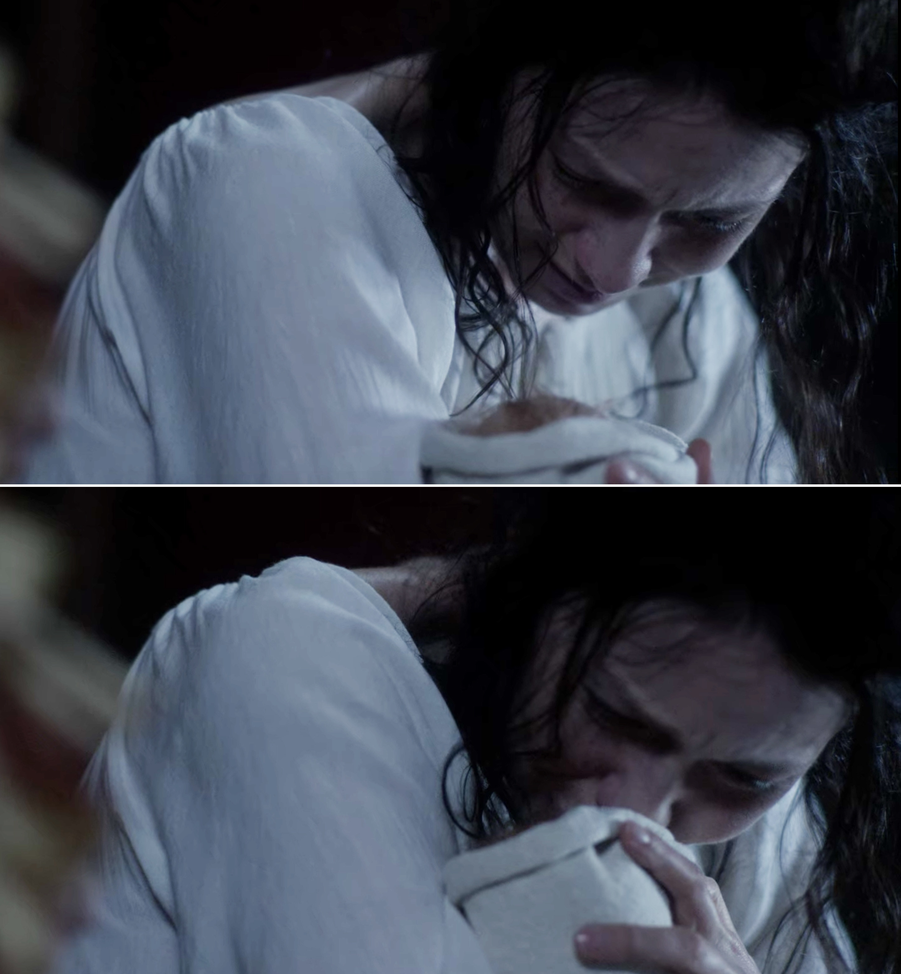 Claire crying and kissing her newborn baby