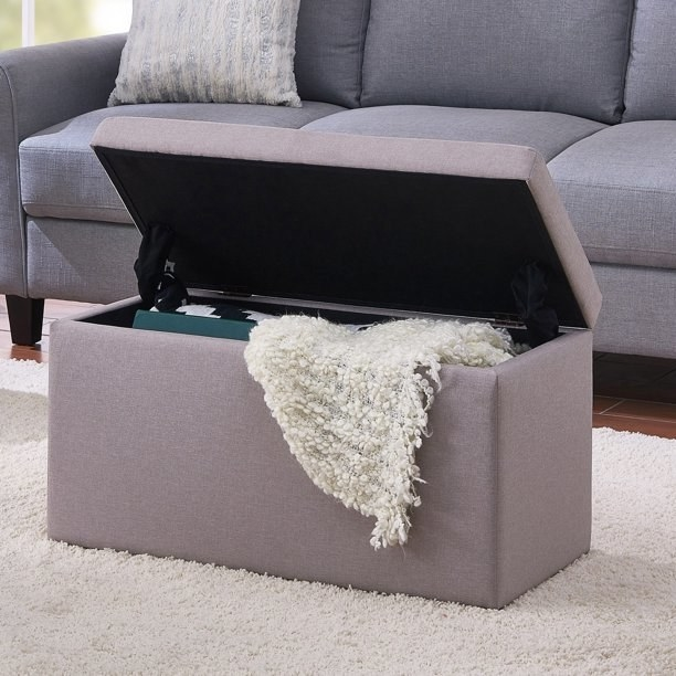 The gray ottoman opened
