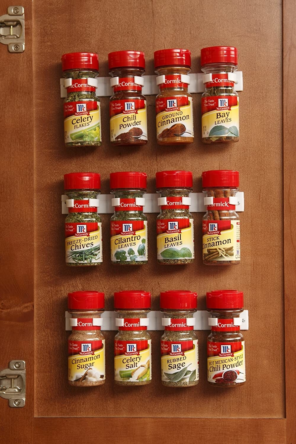 The product being used to organize spices on a cabinet door