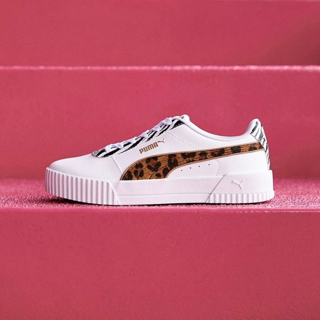 white puma sneakers with a cheetah print accent