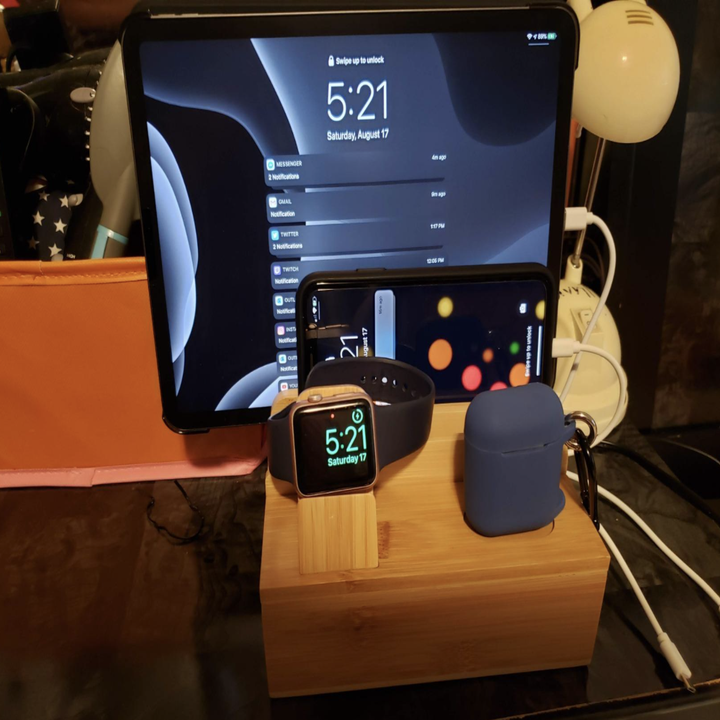 The product storing an iPad, iPhone, Apple Watch, and Airpods