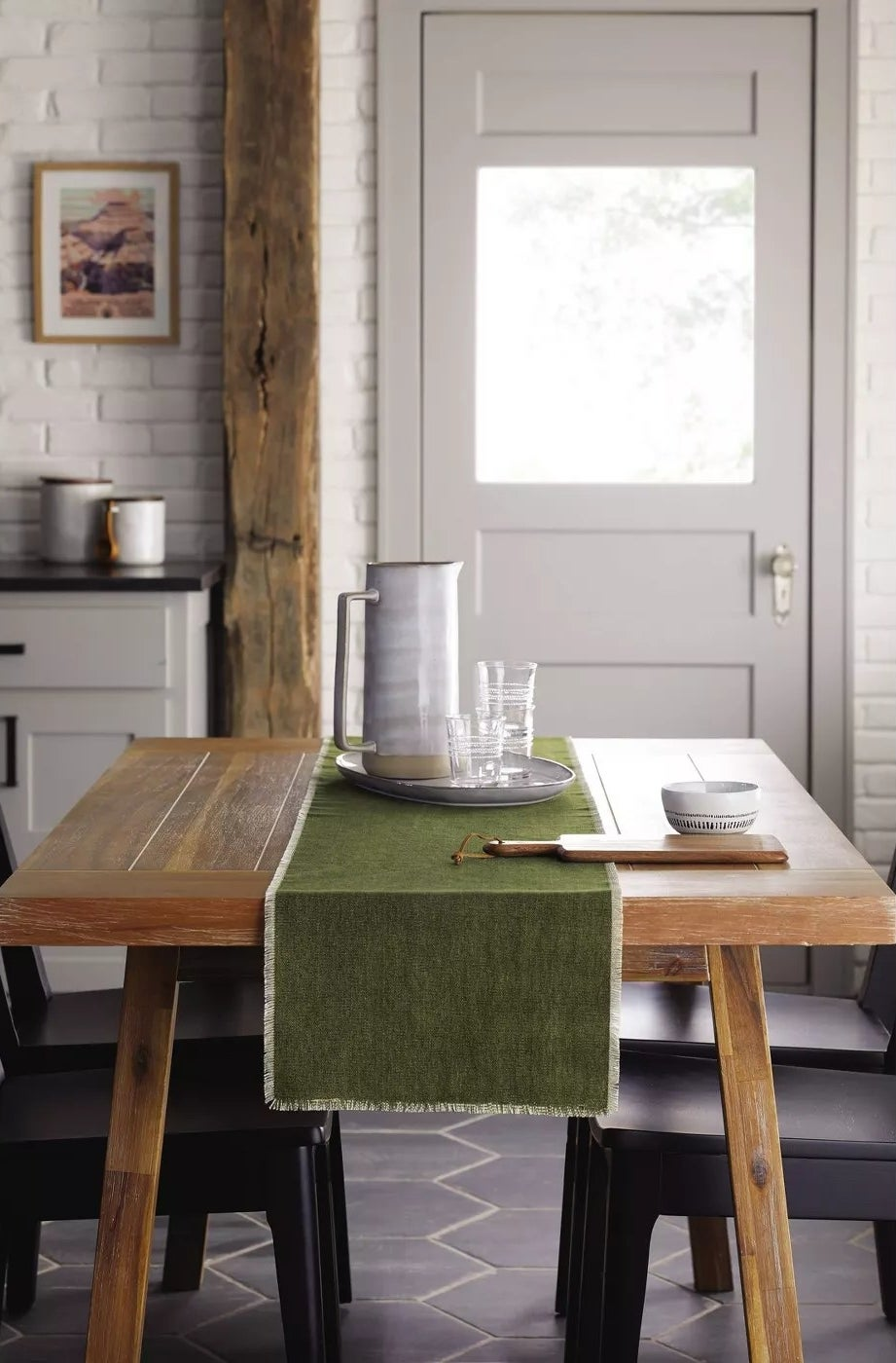 A farmhouse-style dining room table with a rustic finish