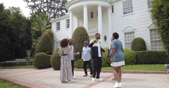 "The Banks and Geoffrey outside the iconic Bel-Air mansion from ""The Fresh Prince."""