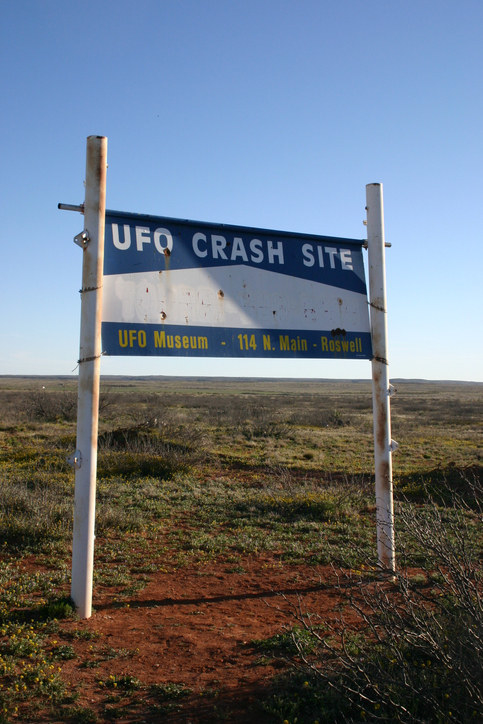 "An old, rusted sign in the middle of nowhere that says ""UFO Crash Site"""