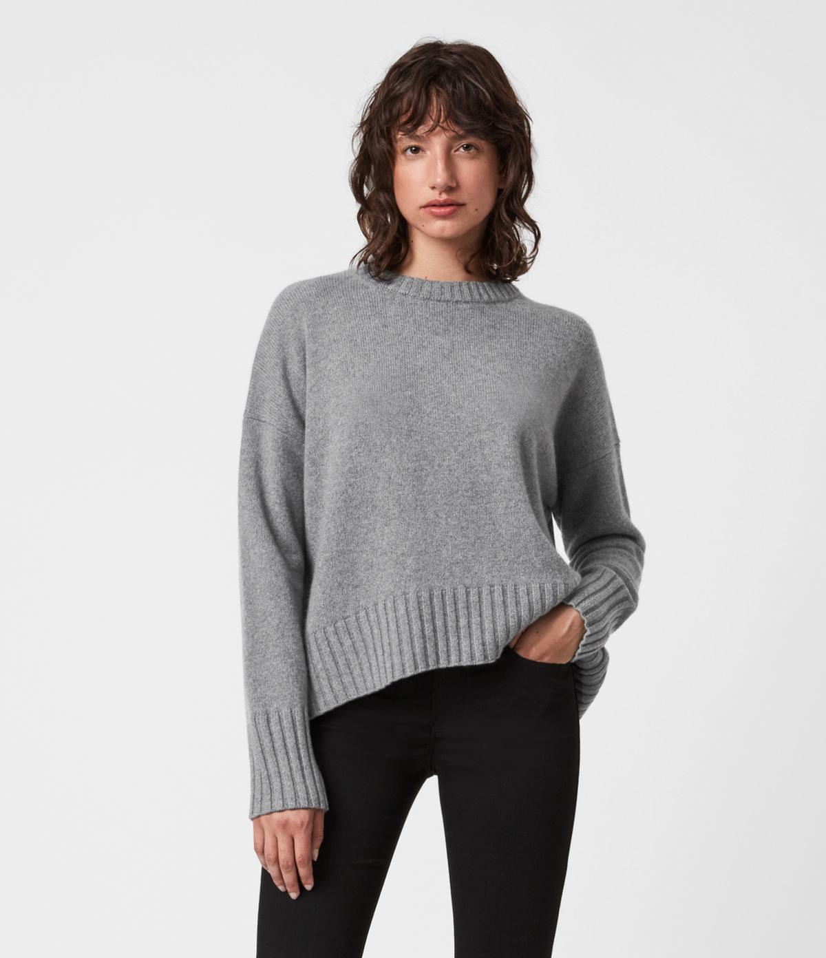a model in a grey sweater