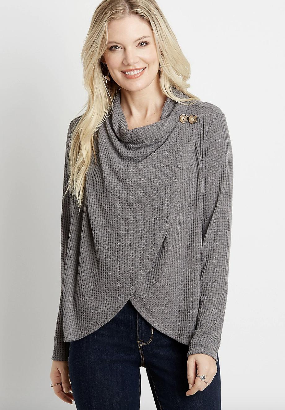 a model in the grey cardigan