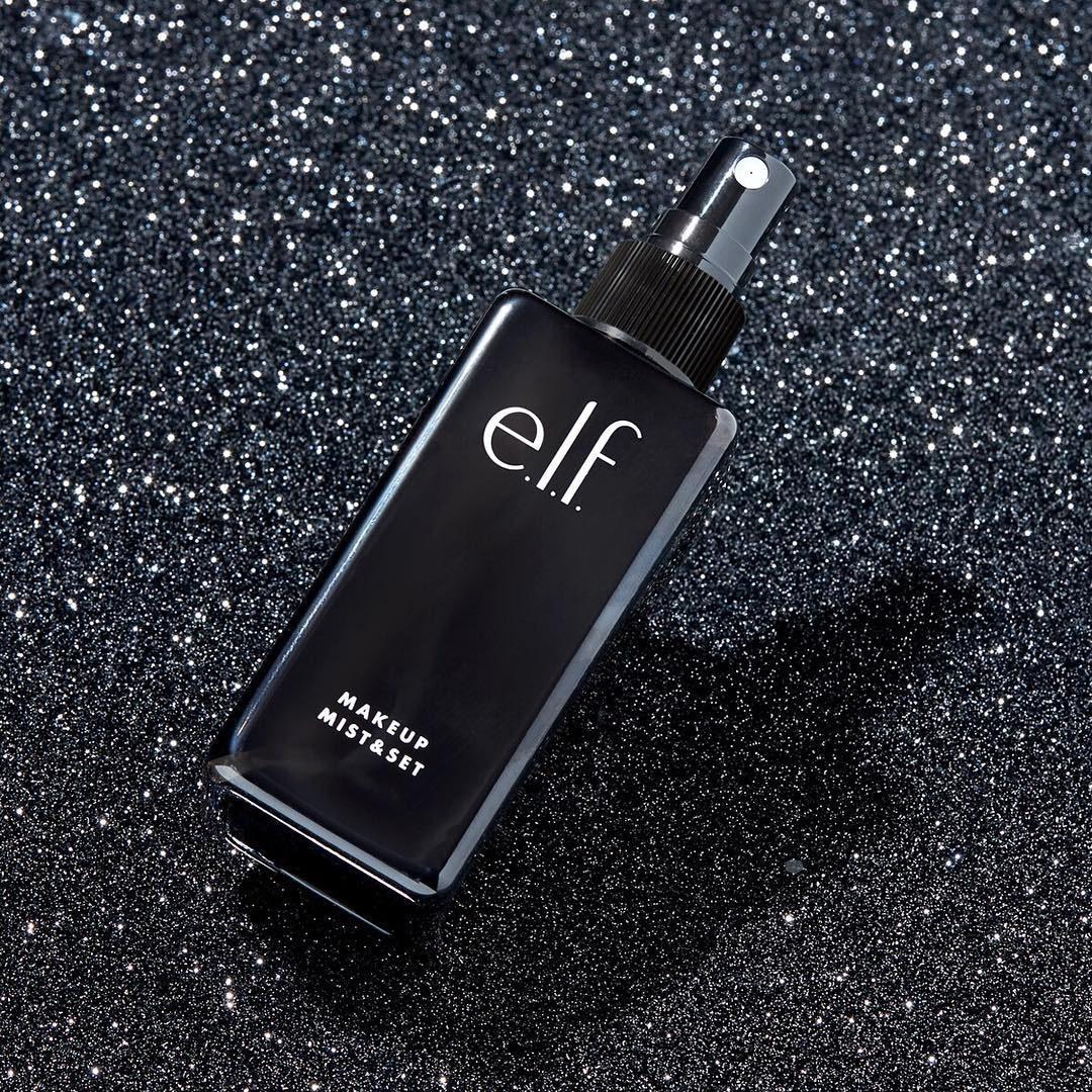 e.l.f. makeup mist and set on black background
