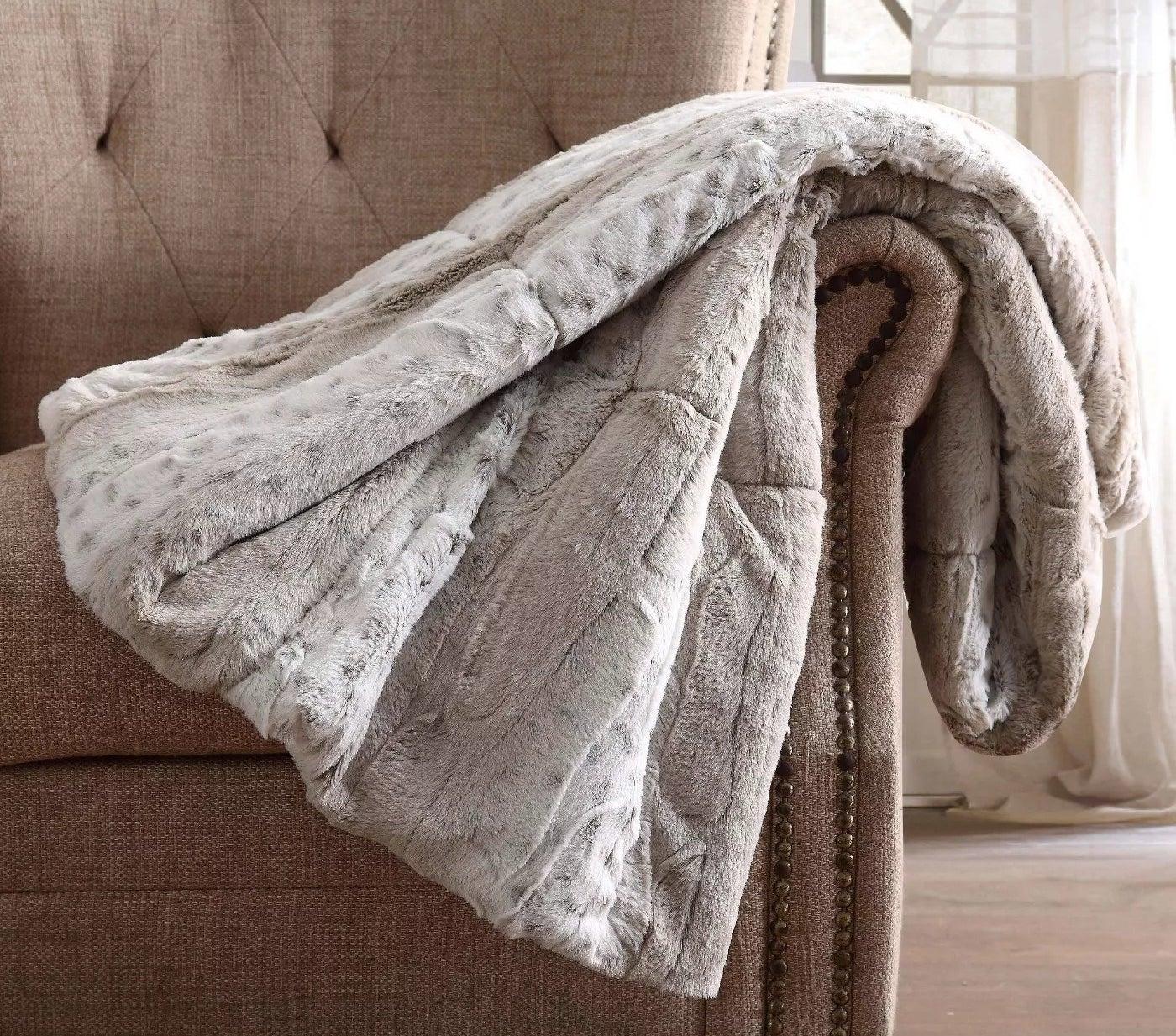 The silver, polyester mink fur reverse blanket