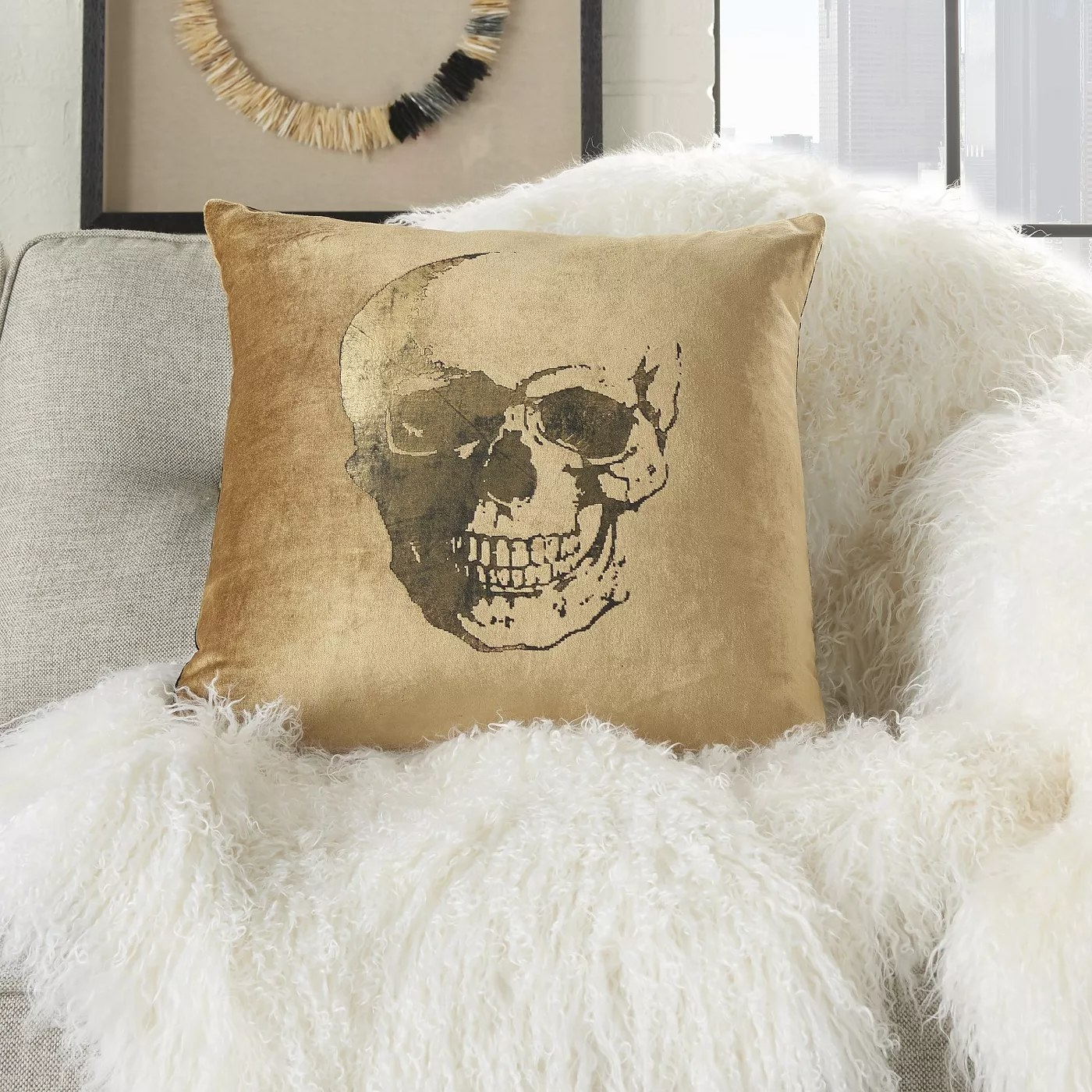 The gold pillow with a skull graphic