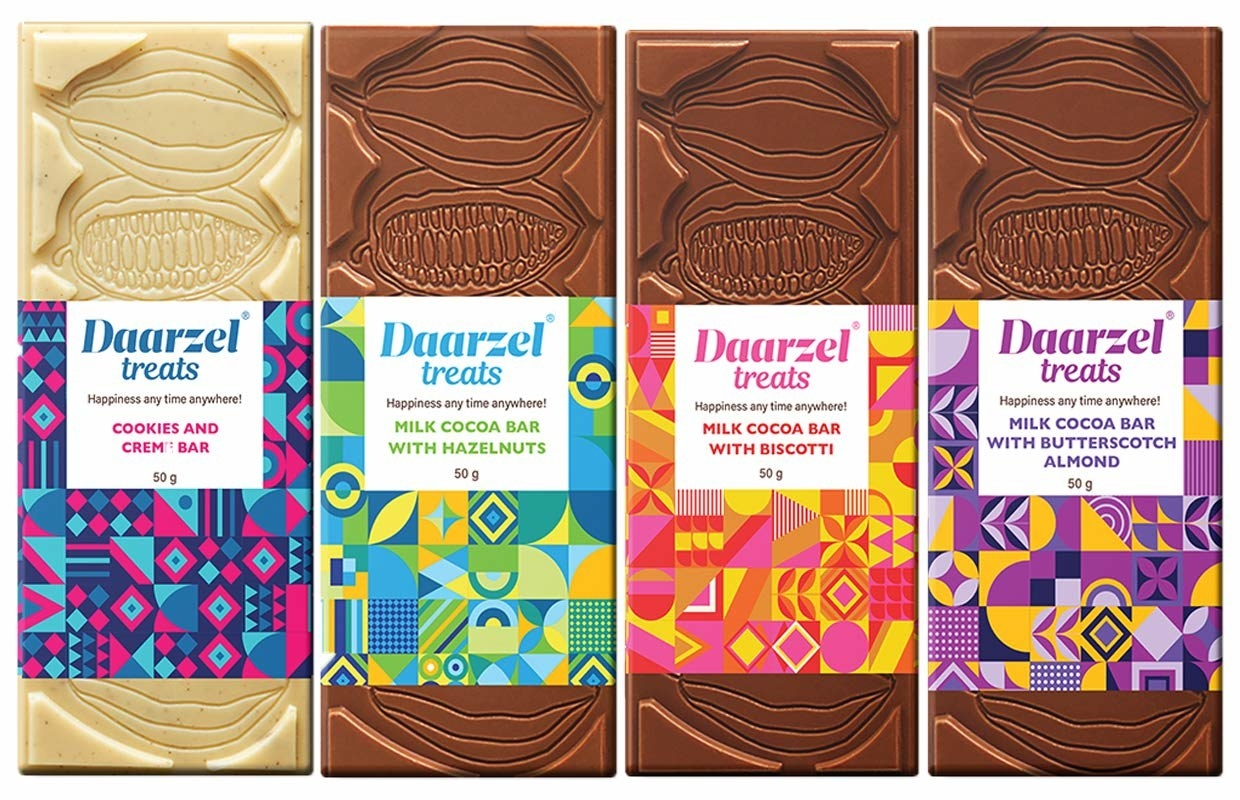 4 chocolate bars with colourful abstract print packaging.
