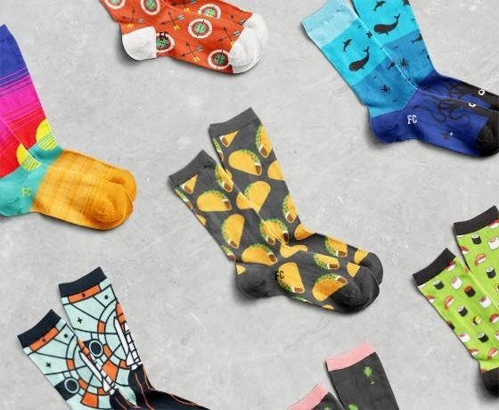 A collection of printed socks, including a taco-print socks, sushi-print socks, and rocket socks